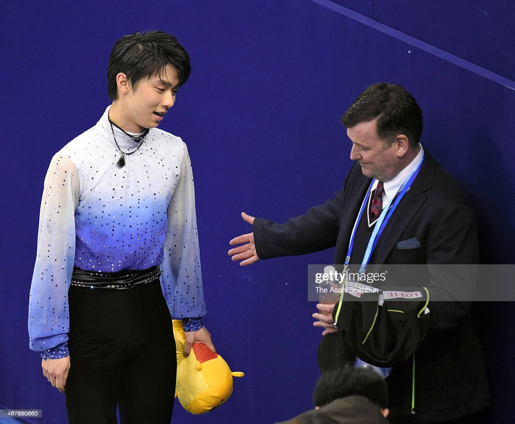 Yuzuru Hanyu of Japan and his coach <a gi-track='captionPersonalityLinkClicked' href=/galleries/search?phrase=Brian+Orser&family=editorial&specificpeople=1138867 ng-click='$event.stopPropagation()'>Brian Orser</a> react after competing in the Men's Short Program on day three of the 2015 ISU World Figure Skating Championships at Shanghai Oriental Sports Center on March 27, 2015 in Shanghai, China.