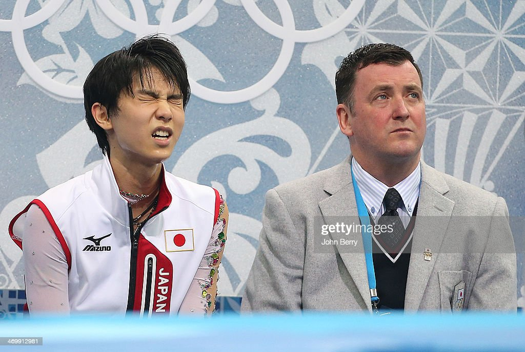 Yuzuru Hanyu of Japan and his coach <a gi-track='captionPersonalityLinkClicked' href=/galleries/search?phrase=Brian+Orser&family=editorial&specificpeople=1138867 ng-click='$event.stopPropagation()'>Brian Orser</a> react to the score in the 'kiss and cry' zone during the Figure Skating Men's Free Skating on day seven of the Sochi 2014 Winter Olympics at Iceberg Skating Palace on February 14, 2014 in Sochi, Russia.