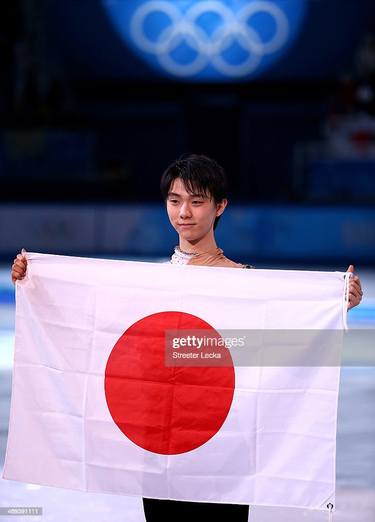Yuzuru Hanyu of Japan celebrates after winning the gold medal in the Figure Skating Men's Free Skating on day seven of the Sochi 2014 Winter Olympics at Iceberg Skating Palace on February 14, 2014 in Sochi, Russia.