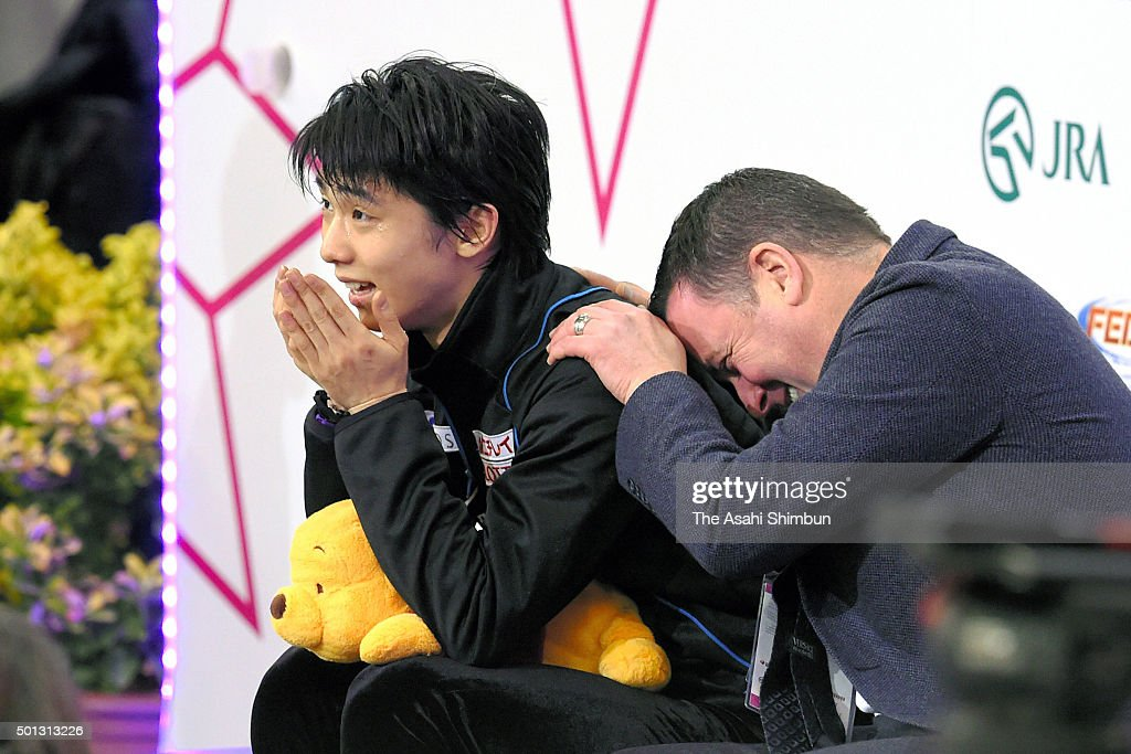 Yuzuru Hanyu (L) of Japan celebrates his score with his coach <a gi-track='captionPersonalityLinkClicked' href=/galleries/search?phrase=Brian+Orser&family=editorial&specificpeople=1138867 ng-click='$event.stopPropagation()'>Brian Orser</a> at the kiss and cry after competing in the Men's Free Skating during day three of the ISU Grand Prix of Figure Skating Final at the Barcelona International Convention Centre on December 12, 2015 in Barcelona, Spain.