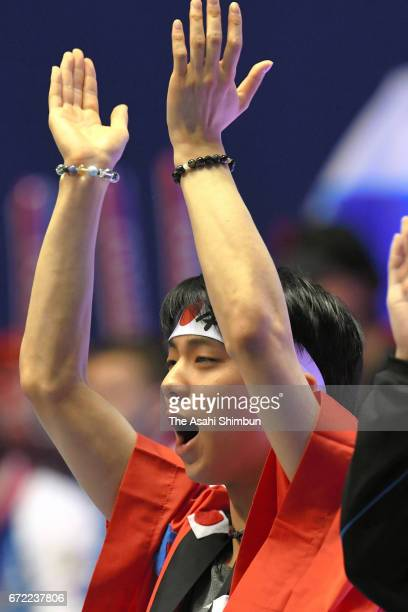 Yuzuru Hanyu of Japan cheer for Wakaba Higuchi and Mai Mihara during day three of the ISU World Team Trophy at Yoyogi Nationala Gymnasium on April 22...