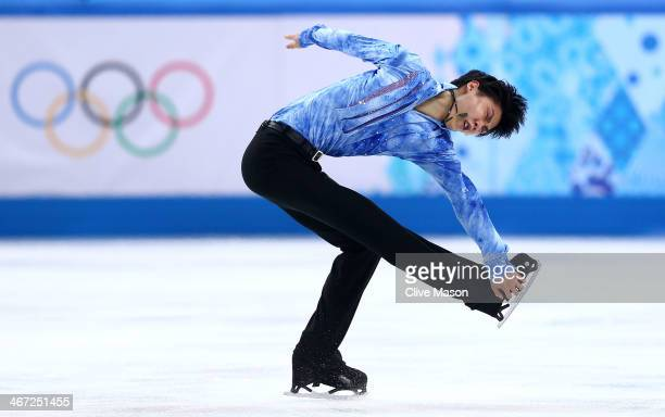 Yuzuru Hanyu of Japan competes in the Figure Skating Men's Short Program during the Sochi 2014 Winter Olympics at Iceberg Skating Palace on February...