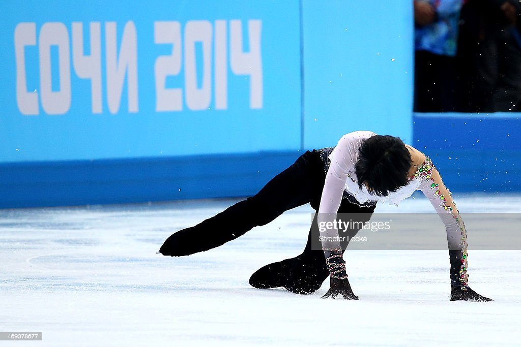 Yuzuru Hanyu of Japan falls as he competes during the Figure Skating Men's Free Skating on day seven of the Sochi 2014 Winter Olympics at Iceberg Skating Palace on February 14, 2014 in Sochi, Russia.