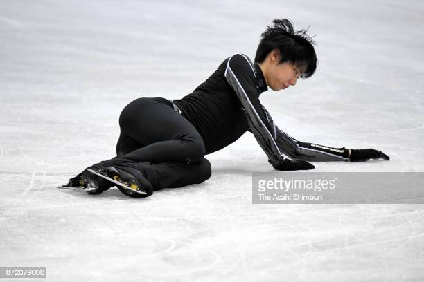 Yuzuru Hanyu of Japan falls during a practice session ahead of the ISU Grand Prix of Figure Skating NHK Trophy at Osaka Municipal Central Gymnasium...