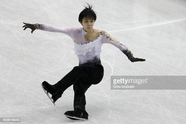 Yuzuru Hanyu of Japan falls during his routine in the Men's Short Program Final on day two of the ISU Grand Prix of Figure Skating Final 2013/2014 at...