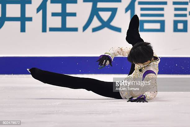 Yuzuru Hanyu of Japan falls in the Men free skating during the day two of the 2015 Japan Figure Skating Championships at the Makomanai Ice Arena on...