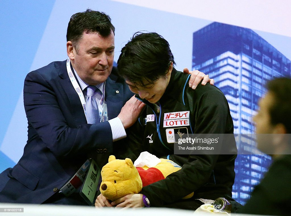 Yuzuru Hanyu of Japan is consoled by his coach Brin Orser after competing in the Men's Singles Free Skating at the kiss and cry during day five of the ISU World Figure Skating Championships 2016 at TD Garden on April 1, 2016 in Boston, Massachusetts.
