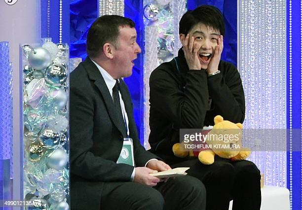 Yuzuru Hanyu of Japan reacts to his score during the men's singles event at the ISU Grand Prix figure skating NHK Trophy in Nagano on November 28...