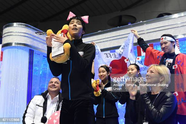 Yuzuru Hanyu of Japan reacts with his team mates at the kiss and cry after the Men free skating during the 2nd day of the ISU World Team Trophy 2017...