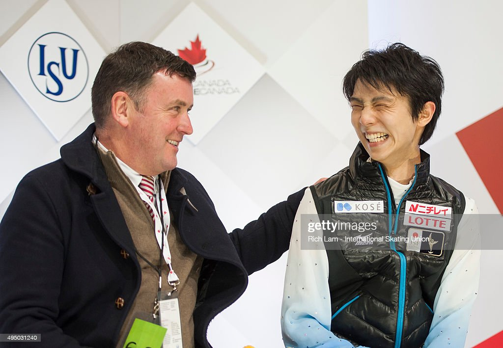 Yuzuru Hanyu of Japan shares a laugh with his coach <a gi-track='captionPersonalityLinkClicked' href=/galleries/search?phrase=Brian+Orser&family=editorial&specificpeople=1138867 ng-click='$event.stopPropagation()'>Brian Orser</a> after skating the Men's Short Program on day one of Skate Canada International ISU Grand Prix of Figure Skating, October, 30, 2015 at ENMAX Centre in Lethbridge, Alberta, Canada.