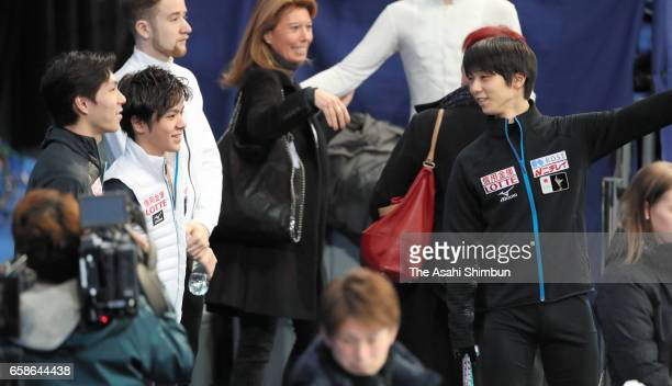 Yuzuru Hanyu of Japan talks to Shoma Uno and Keiji Tanaka during a practice session ahead of the World Figure Skating Championships on March 27 2017...