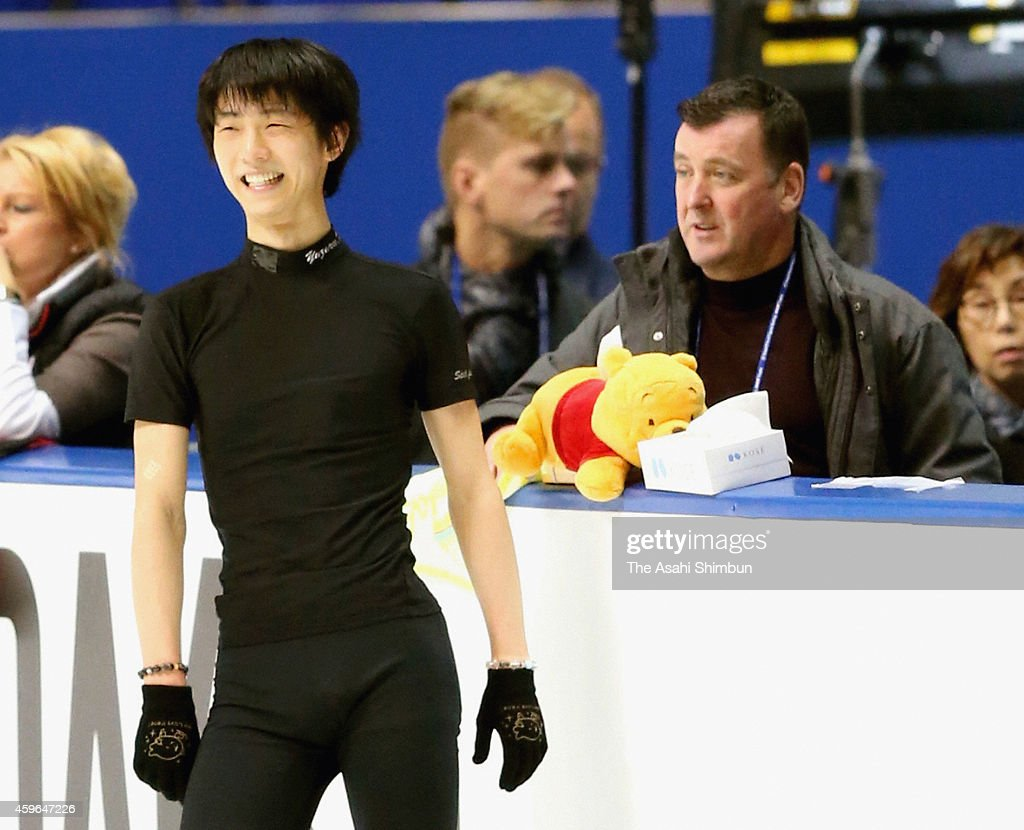 Yuzuru Hanyu of Japan talks with his coach <a gi-track='captionPersonalityLinkClicked' href=/galleries/search?phrase=Brian+Orser&family=editorial&specificpeople=1138867 ng-click='$event.stopPropagation()'>Brian Orser</a> during a practice session ahead of the NHK Trophy figureskating at Namihaya Dome on November 27, 2014 in Kadoma, Osaka, Japan.