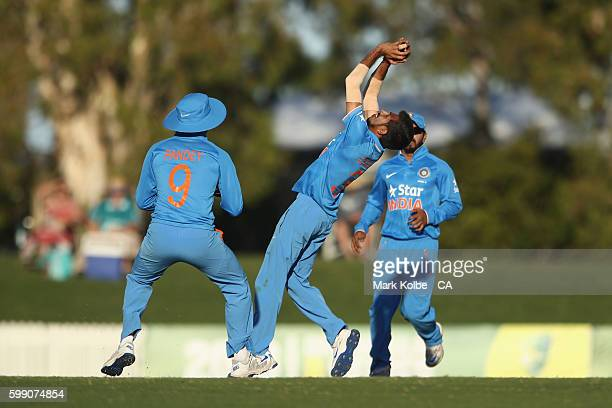Yuzvendra Chahal of India A takes the catch off his own bowling to dismiss Kane Richardson of Australia during the Cricket Australia Winter Series...