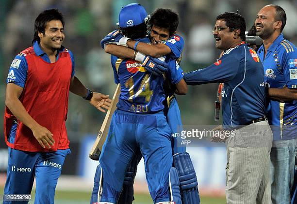 Yuzvendra Chahal of Mumbai Indians is hugged by his team mates after Mumbai Indian won the Champions League Twenty20 League group B match against...