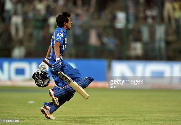 Yuzvendra Chahal of Mumbai Indians runs towards his team mates after making two runs required in the last ball during the Champions League Twenty20...