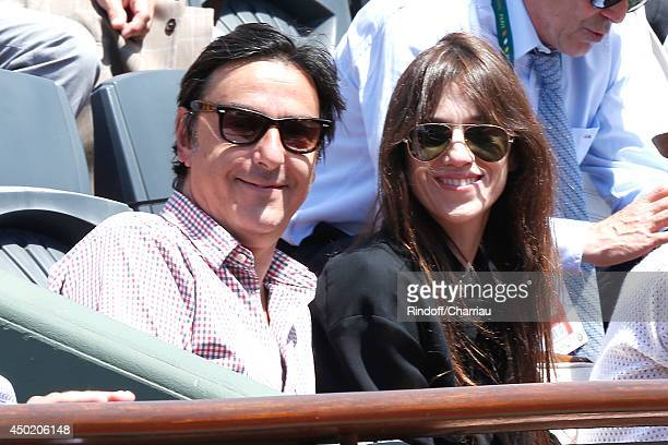 Yvan Attal and Charlotte Gainsbourg attend the Roland Garros French Tennis Open 2014 Day 13 on June 6 2014 in Paris France