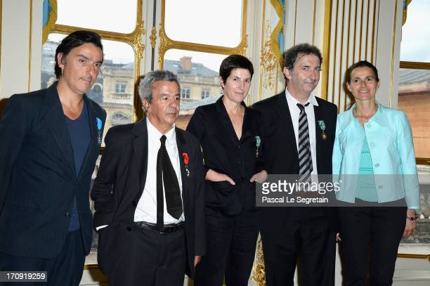 Yvan Attal Maurice Benichou Christine Angot and Francois Morel pose with Aurelie Filippetti after the Honour Ceremony hosted by the French Ministry...