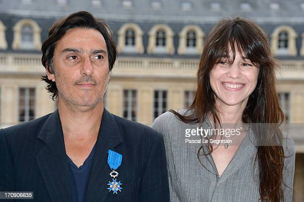 Yvan Attal pose with Charlotte Gainsbourg after being honored 'Chevalier de l'Ordre National du Merite' by the French Minister for Culture Aurelie...
