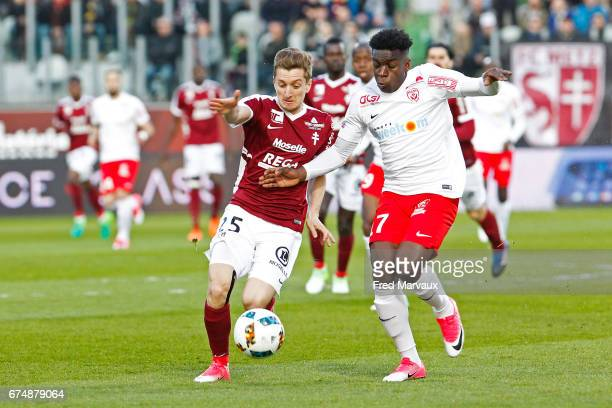 Yvan Balliu of Metz and Faitout Maouassa of Nancy during the French Ligue 1 match between Metz and Nancy at Stade SaintSymphorien on April 29 2017 in...