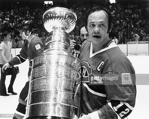 Yvan Cournoyer of the Montreal Canadiens poses for a photo with the Stanley Cup Trophy after winning Game 4 of the 1976 Stanley Cup Finals against...