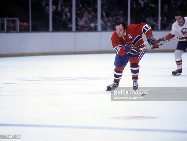 Yvan Cournoyer of the Montreal Canadiens skates with the puck during an NHL game against the New York Islanders circa 1974 at the Nassau Coliseum in...