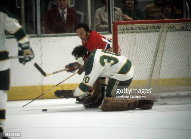 Yvan Cournoyer of the Montreal Canadines looks to attach as goalie Cesar Maniago of the Minnesota North Stars tries to cover the puck circa 1972 at...
