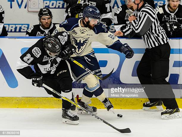 Yvan Mongo of the BlainvilleBoisbriand Armada and Marek Zachar of the Sherbrooke Phoenix battle for the puck during the QMJHL game at the Centre...