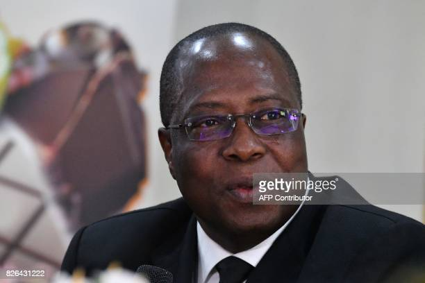 Yves Brahima Kone newly appointed director of the Ivorian Cocoa Coffee Council speaks after a handover ceremony in Abidjan on August 4 2017 The...
