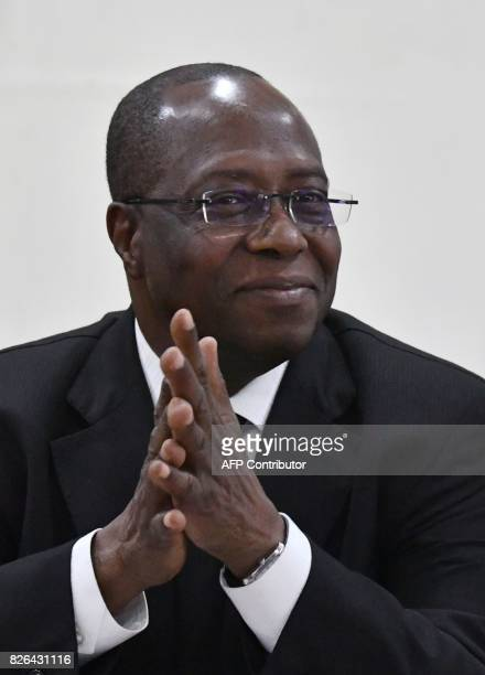 Yves Brahima Kone newly appointed director of the Ivorian Cocoa Coffee Council looks on after a handover ceremony in Abidjan on August 4 2017 The...