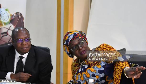 Yves Brahima Kone newly appointed director of the Ivorian Cocoa Coffee Council speaks to his predecessor Massandje ToureListe during a handover...