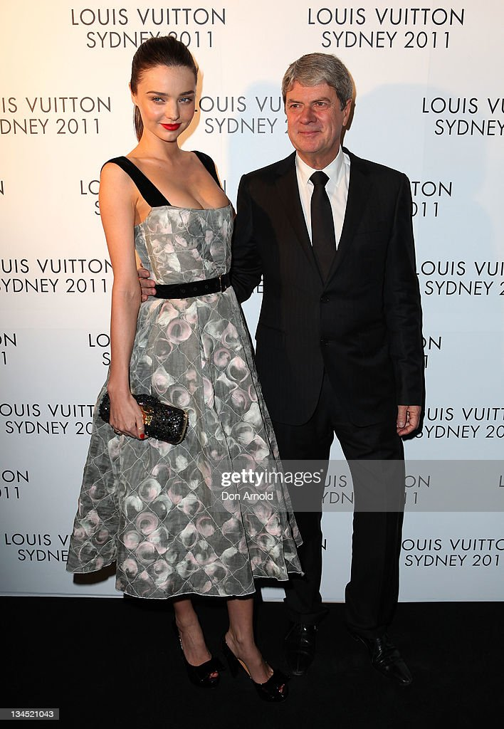 Yves Carcelle and Miranda Kerr arrive at the Louis Vuitton Maison reception on December 2 2011 in Sydney Australia