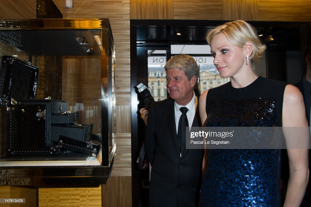 <a gi-track='captionPersonalityLinkClicked' href=/galleries/search?phrase=Yves+Carcelle&family=editorial&specificpeople=224753 ng-click='$event.stopPropagation()'>Yves Carcelle</a> and Princess Charlene attend the Louis Vuitton new boutique opening as part of Paris Haute-Couture Fashion Week Fall / Winter 2012/13 at Place Vendome on July 3, 2012 in Paris, France.