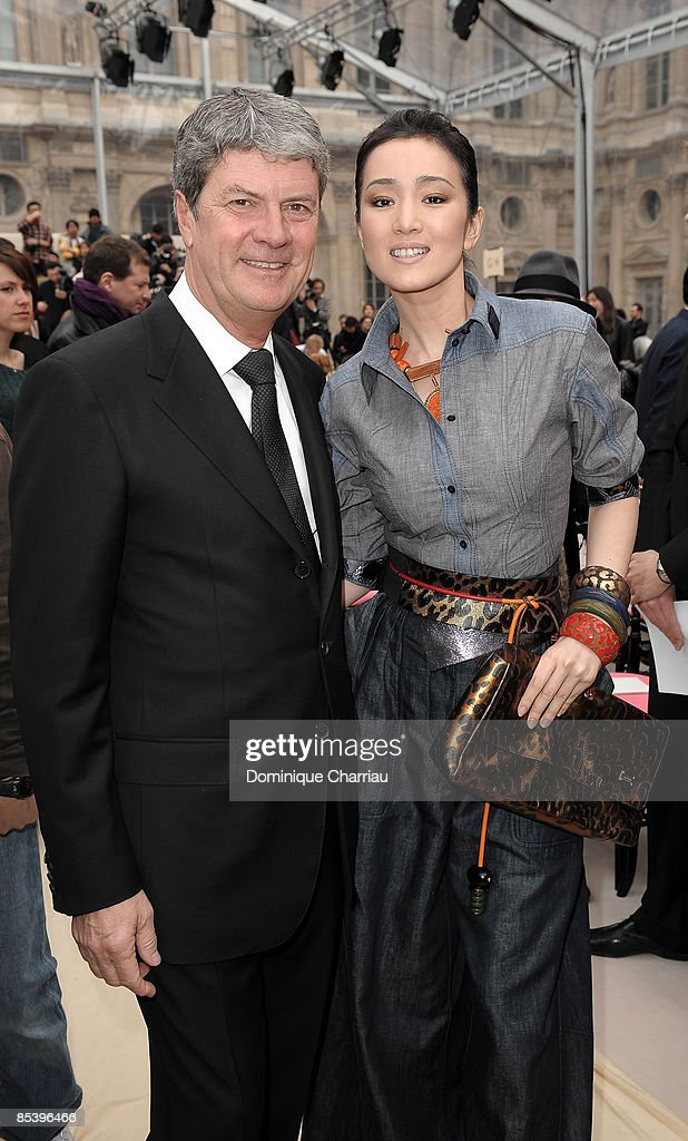 Yves Carcelle chairman and chief executive Louis Vuitton and Chinese Actrice Gong Li attend the Louis Vuitton ReadytoWear A/W 2009 fashion show...