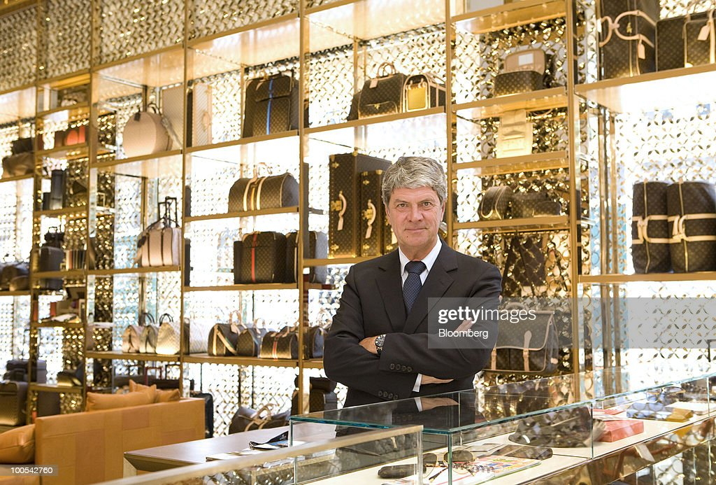 Yves Carcelle, chief executive officer of Louis Vuitton, poses for a photograph at the Louis Vuitton 'maison,' the flagship store for LVMH Moet Hennessy Louis Vuitton SA, in New Bond Street in London, U.K., on Tuesday, May 25, 2010. The new London LV maison has been designed by the New York-based architect, Peter Marino, who also worked on the brand's Champs Elysees maison. Photographer: Chris Ratcliffe/Bloomberg via Getty Images