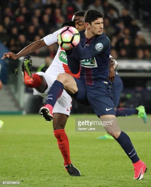 Yves Dabila of AS Monaco in action with Goncalo Guedes of Paris SaintGermain during the French Cup SemiFinal match between Paris SaintGermain and As...