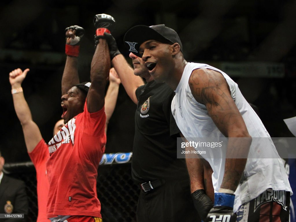 Yves Jabouin (L) and Walel Watson (R) react after Jabouin is announced the winner by split decision in their bout during the UFC 140 event at Air Canada Centre on December 10, 2011 in Toronto, Ontario, Canada.