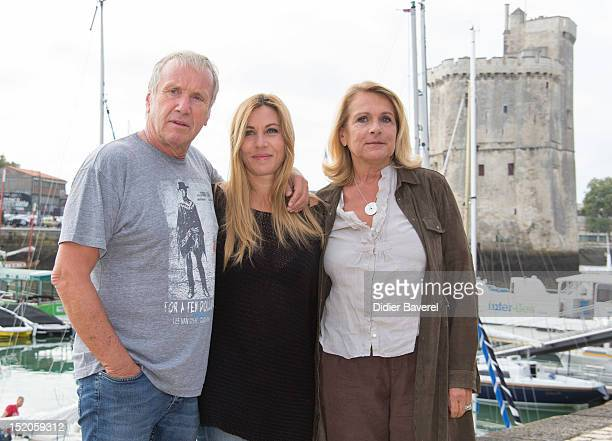Yves Renier Mathilde Seigner and the writer Veronique Vasseur pose during the 'Medecin chef de la sante' Photocall at La Rochelle Fiction Television...