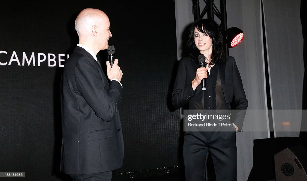 CEO Yves Saint Laurent Beaute Stephan Bezy and Yves Saint Laurent new muse Edie Campbell attend the Cocktail for the discovery of new fragrance 'Black Opium' by Yves Saint Laurent on May 6, 2014 in Paris, France..