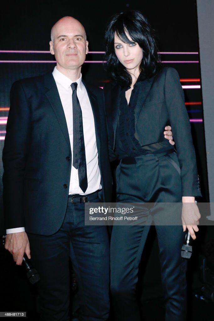 CEO Yves Saint Laurent Beaute Stephan Bezy and Yves Saint Laurent new muse <a gi-track='captionPersonalityLinkClicked' href=/galleries/search?phrase=Edie+Campbell&family=editorial&specificpeople=6554506 ng-click='$event.stopPropagation()'>Edie Campbell</a> attend the Cocktail for the discovery of new fragrance 'Black Opium' by Yves Saint Laurent on May 6, 2014 in Paris, France..