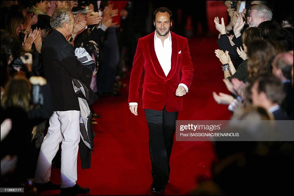 Yves Saint Laurent FallWinter 20042005 readytowear Fashion Show in Paris France On March 07 2004Tom Ford in his red velvet jacket for his valedictory...