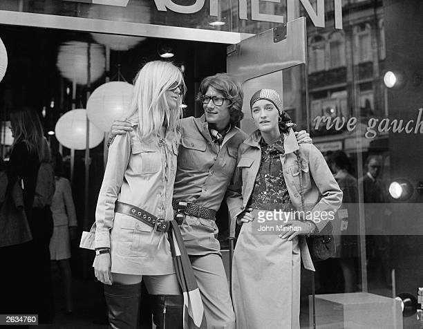 Yves Saint Laurent French designer with two fashion models Betty Catroux and Loulou de la Falaise outside his 'Rive Gauche' shop