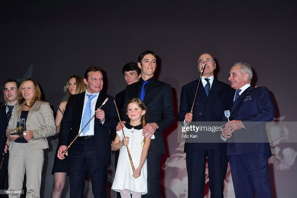 Yves Saint Martin, France Galop President Bertrand Belinguier, Christophe Soumillon, his daughter Charlie, David Cottin, Christophe Pieux, a guest, Nathalie Desoutter and guest attend the 'Cravaches D'Or' Awards 2013 At Theatre des Champs Elysees In Paris on April 3, 2013 in Paris, France.