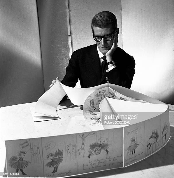 Yves SaintLaurent working on his sketchs on June 5 1964 in Paris France