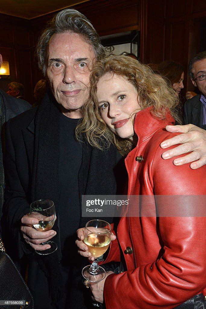 Yves Simon and Florence Darel attend the Francis Boussard's and Nadine Carpentier's : Private Cocktail At Cafe de Flore on April 30, 2014 in Paris, France.