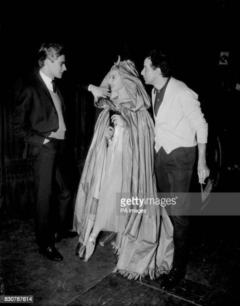 Yves St Laurent chief designer for the House of Dior and Rolad Petit the choreographer discuss the costume worn by Colette 'Legs' Marchand who will...