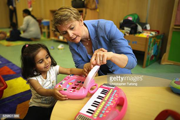 Yvette Cooper MP talks to a young girl at Palfrey Sure Start Centre as she joins the Labour In battle bus to campaign in the West Midlands on June 13...
