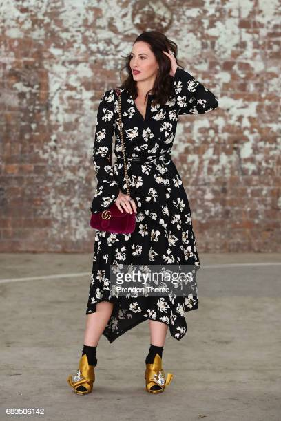 Yvette Hardy wearing Proenza shoulder dress No21 shoes Gucci bag during MercedesBenz Fashion Week Resort 18 Collections at Carriageworks on May 16...