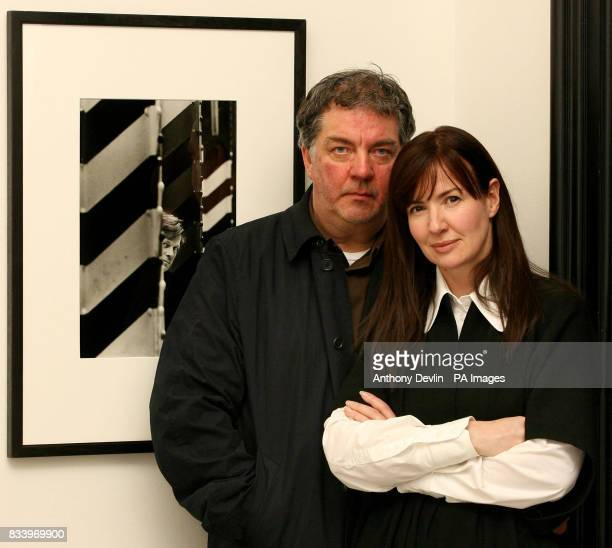 Yvette Livesey and Kevin Cummins pose with a portrait of Tony Wilson taken by Cummins at Manchester's Hacienda nightclub in 1985 as it goes on...