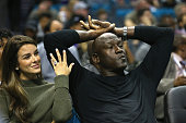 Yvette Prieto and her husband and owner of the Charlotte Hornets Michael Jordan watch on during their game against the Atlanta Hawks at Time Warner...
