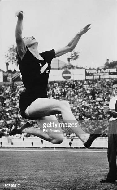 Yvette Williams of New Zealand wins the Long Jump with a leap of 19 feet four inches at Eden Park stadium during the British Empire Games in Auckland...